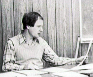Terry at desk in math room